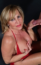 Blond cougar, Piper O'Toole gives hand job.